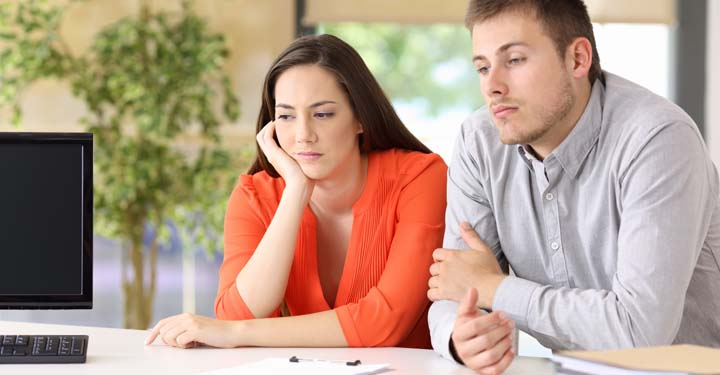 Woman and man sitting next to each other appearing upset