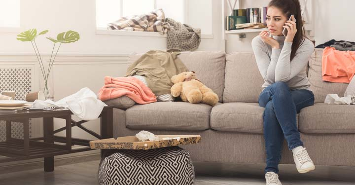 Woman talking on the phone sitting on a couch