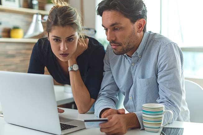 Two people looking at computer screen