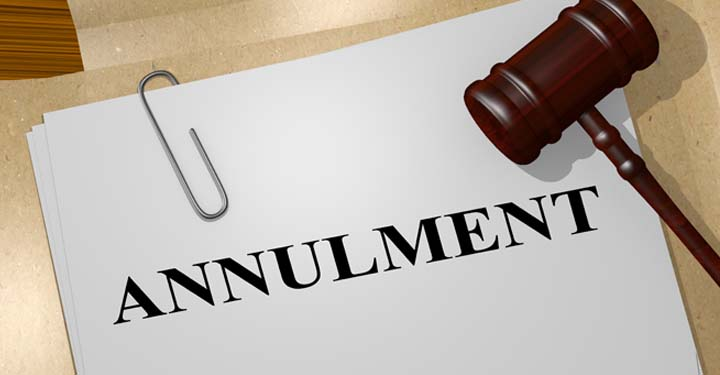 "Piece of paper labeled ""Annulment"" next to a gavel"