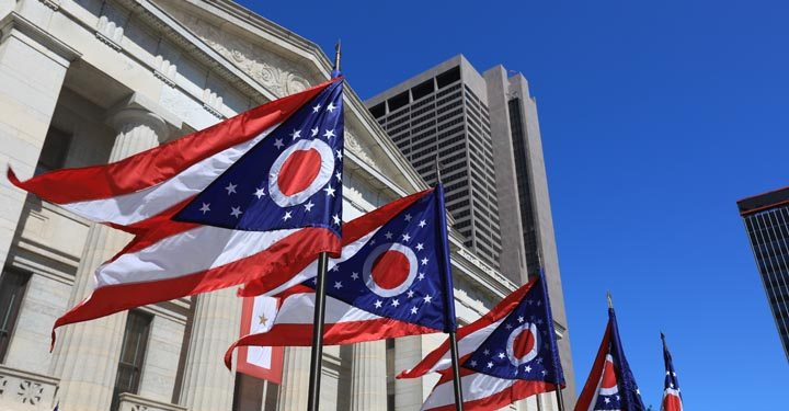 Ohio flags in front of a government building