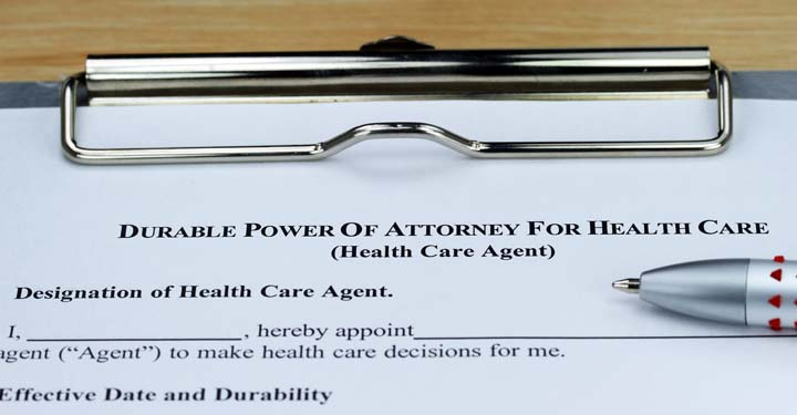 "Document labeled ""Durable Power of Attorney for Health Care"" on a clipboard"