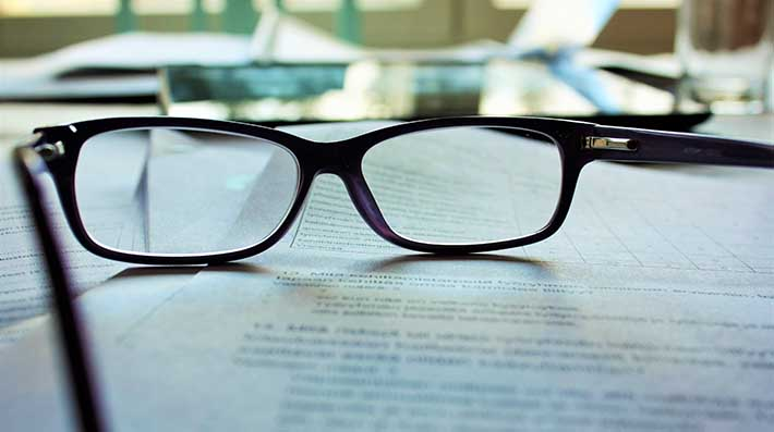 Glasses resting on documents